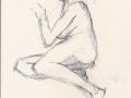 Nude sitting.