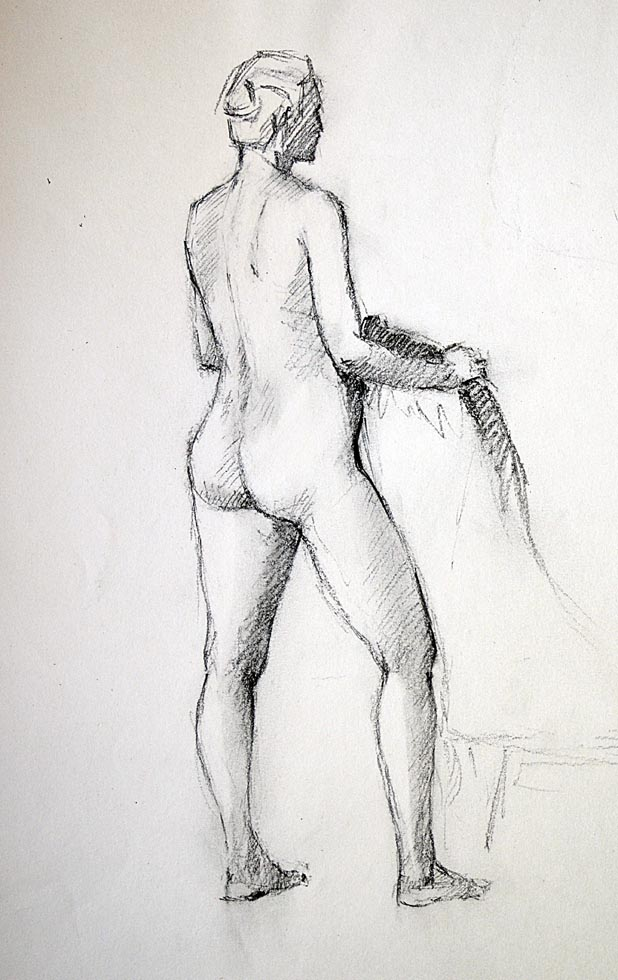 Female nude standing with chair