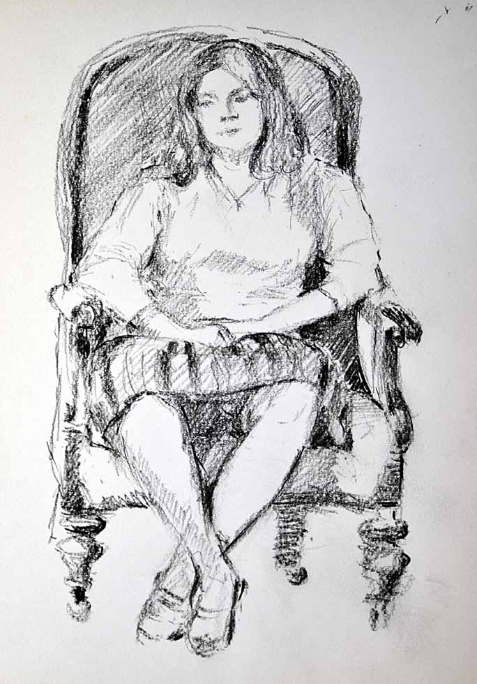 Female seated in chair