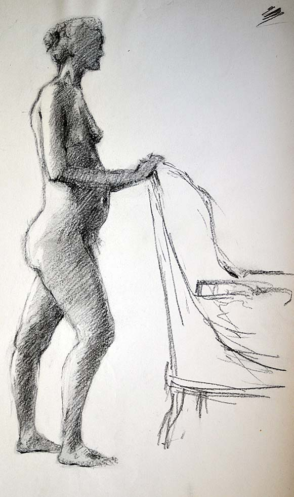 Standing female nude with chair